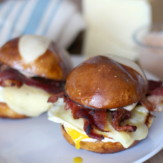 Egg, White Cheddar, and Bacon Breakfast Sandwiches on Pretzel Buns